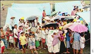 evacuees in front of tents