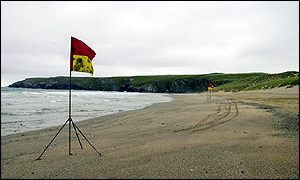 Warning flags fly on Holywell Beach