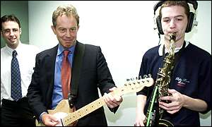 Tony Blair plays the guitar alongside Andrew Cragg, 15, at Dyke House School in Hartlepool