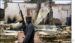 Soldier inspects patrols Kaduna after February 2000 riots