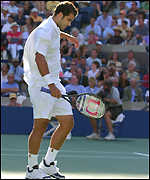 Pete Sampras looks distraught during his final defeat by Lleyton Hewitt