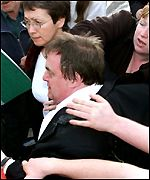 John Prescott led away from a scuffle in Rhyl