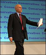Iain Duncan Smith walks to the podium to make his acceptance speech