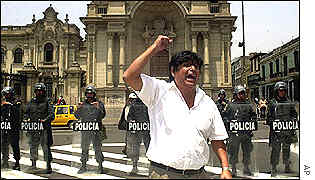 A man celebrates after hearing of the resignation of Alberto Fujimori