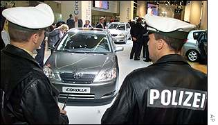 Policemen guard the motor show