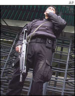 An elite bomb squad officer guards the US embassy in Mexico City
