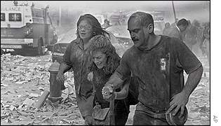 People make their way amid debris near the World Trade Center