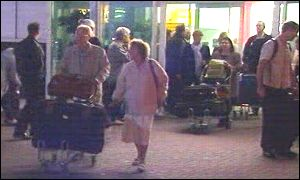 Passengers from a diverted flight arrive in Cardiff