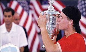 Hewitt celebrates as Sampras fades into the background