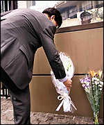 A man lays flowers outside US embassy in Tokyo