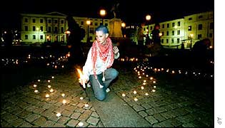 Lighting candles for the dead in Sweden