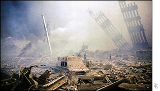 Firefighters struggle through the rubble of the World Trade Center