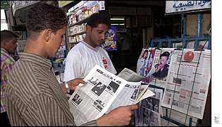 Iraqi youths at Baghdad news-stand