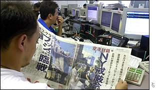 Japanese traders digest the New York news