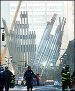 Workers search the base of the World Trade Center