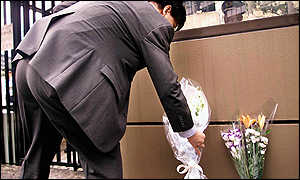 Tokyo man lays flowers outside US embassy