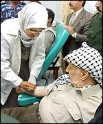 Palestinian leader Yasser Arafat donates blood at Shifa hospital in the Gaza Strip