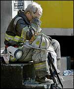 Firefighter rests his head in his hands