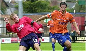 York City's Michael Proctor (left) in action against Luton's Aaron Skelton