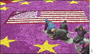 A commemorative carpet of flowers is laid in Frankfurt