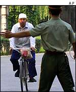 Beijing policeman diverts cyclist approaching US Embassy