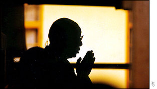 The Dalai Lama prays in India for victims of the attack