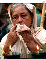 An Indian prays for victims of the attack