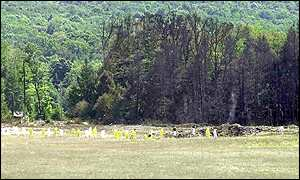 Investigators search the crash site of United Airlines Flight 93