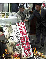 Burning poster of Osama Bin Laden