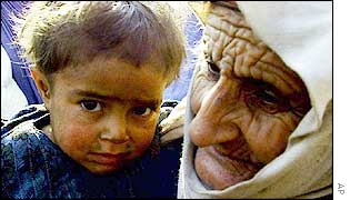 A grandmother holds a sick child
