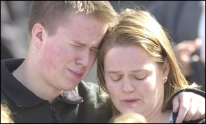 A tearful couple at St Paul's Cathedral