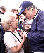 New York City Mayor Rudolph Giuliani consoles the mother of a missing Cantor worker