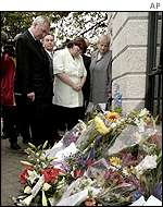 Irish PM Bertie Ahern looking at floral tribute outside embassy