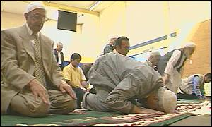 Men pray in a west London community centre