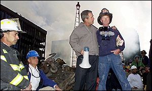 George W Bush with a NYC firefighter