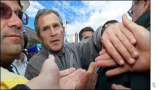 Bush surrounded by rescue workers