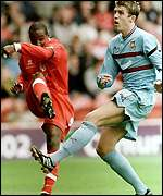 Boro's Paul Ince, left, is challenged by Michael Carrick