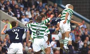 Henrik Larsson heads home his first goal at Dens Park