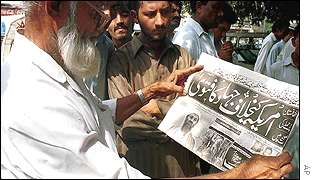 Residents of Karachi read headlines about