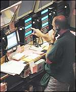 Technician checking trading systems on Wall Street