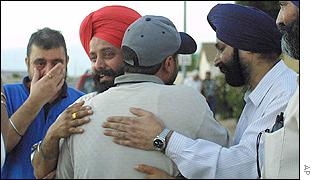 Relatives of Balbir Singh Sodhi, an immigrant from India, comfort each other at the scene of his shooting in Mesa, Arizona