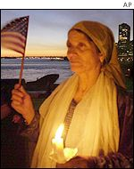 A Palestinian-American participates in a candlelit vigil in New York