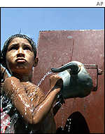 A boy bathes in a refugee camp in Jalozai, Pakistan
