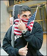 Man covering his face with a flag