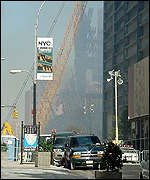 Crane moving debris away from the collapsed twin towers of the World Trade Center