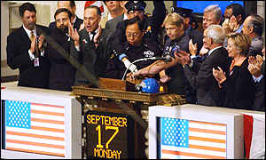 Police officers ring the opening bell at the New York Stock Exchange