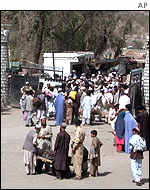 Afghan refugees streaming through the border between Afghanistan and Pakistan before it closed