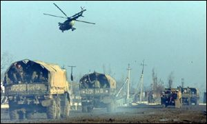 Russian forces helicopter heads into Grozny