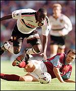 [ image: Neil Ruddock tangles with new-boy Dwight Yorke]