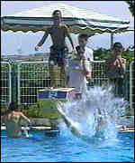 [ image: Children at Ariel cool off in pool]